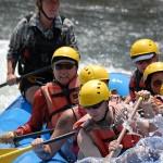 Courtney guides a boat through Satan's Cesspool rapid.