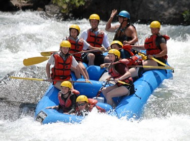 Hotshot rafting photo of guests preparing for wave at bottom of troublemaker