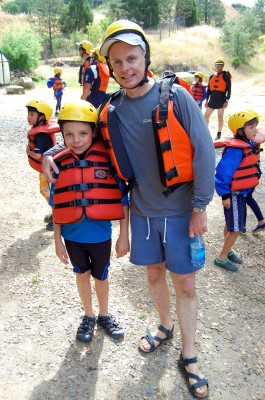 Father and son prepare to head out rafting!