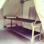 Canvas cot structures are found in each of our Canvas Cabin Tents. This is an example of a 4 person canvas cabin tent.