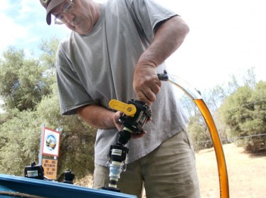 Scott collecting vegetable oil for fuel